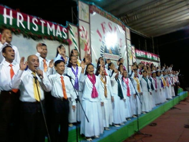 Adults Choir singing during the Thanksgiving celebration on Friday overnight service at Amoranto Stadium.